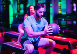 BMF Trainer, Matthew Barron, taking a lower body workout